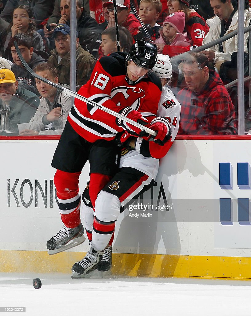 Stephane Da Costa #24 of the Ottawa Senators is checked into the boards by <a gi-track='captionPersonalityLinkClicked' href=/galleries/search?phrase=Steve+Bernier&family=editorial&specificpeople=557040 ng-click='$event.stopPropagation()'>Steve Bernier</a> #18 of the New Jersey Devils during the game at the Prudential Center on February 18, 2013 in Newark, New Jersey.