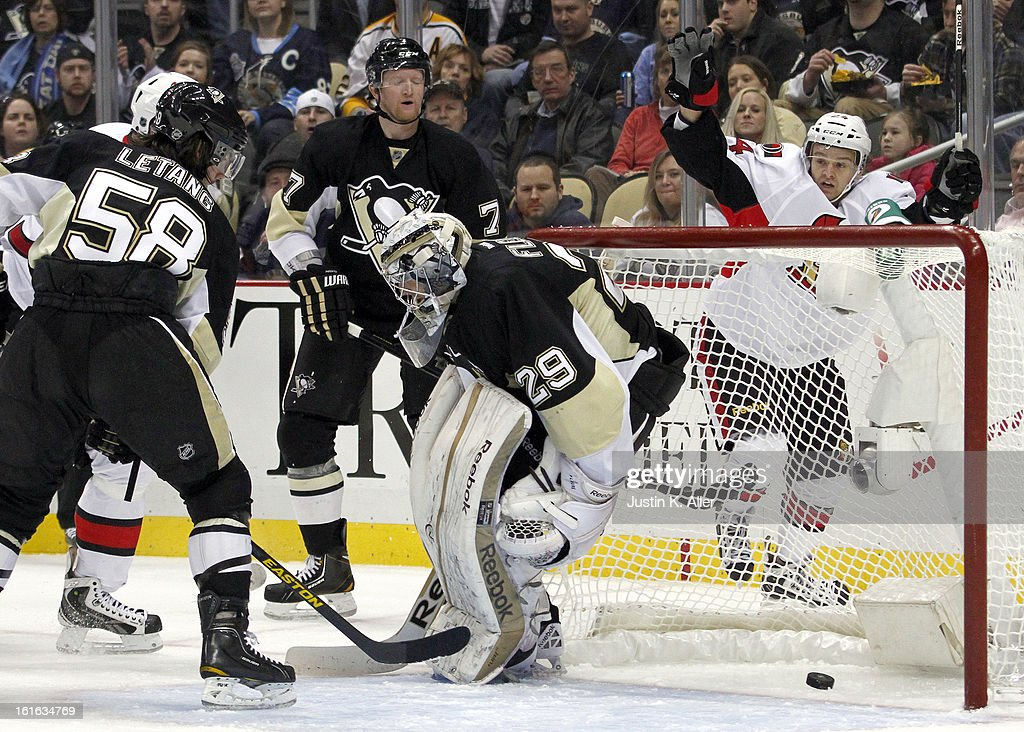 Stephane Da Costa #24 of the Ottawa Senators scores past Marc-Andre Fleury #29 of the Pittsburgh Penguins during the game at Consol Energy Center on February 13, 2013 in Pittsburgh, Pennsylvania.