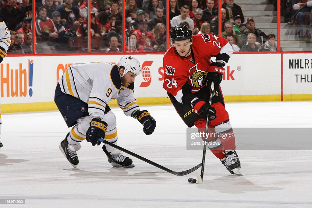 Stephane Da Costa #24 of the Ottawa Senators stickhandles the puck against Steve Ott #9 of the Buffalo Sabres during an NHL game at Canadian Tire Centre on February 6, 2014 in Ottawa, Ontario, Canada.