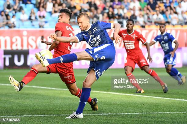Stephane Darbion of Troyes and Rami Bensebaini of Rennes during the Ligue 1 match between Troyes AC and Stade Rennais at Stade de l'Aube on August 5...