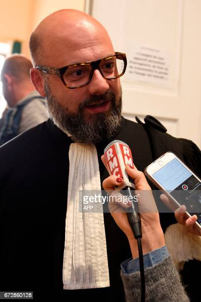 CORRECTION Stephane Giuranna lawyer of Francis Heaulme speaks to journalists during the trial of his client on April 25 2017 in Metz eastern France...
