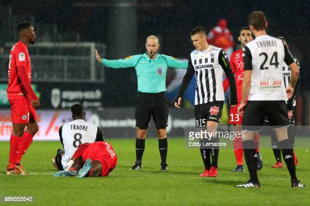 Stephane Jochem referee with Ismael Traore of Angers during the Ligue 1 match between Angers SCO and Montpellier Herault SC at Stade Raymond Kopa on...