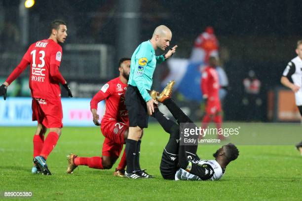 Stephane Jochem the referee is holding the shoes of Ismael Traore of Angers during the Ligue 1 match between Angers SCO and Montpellier Herault SC at...