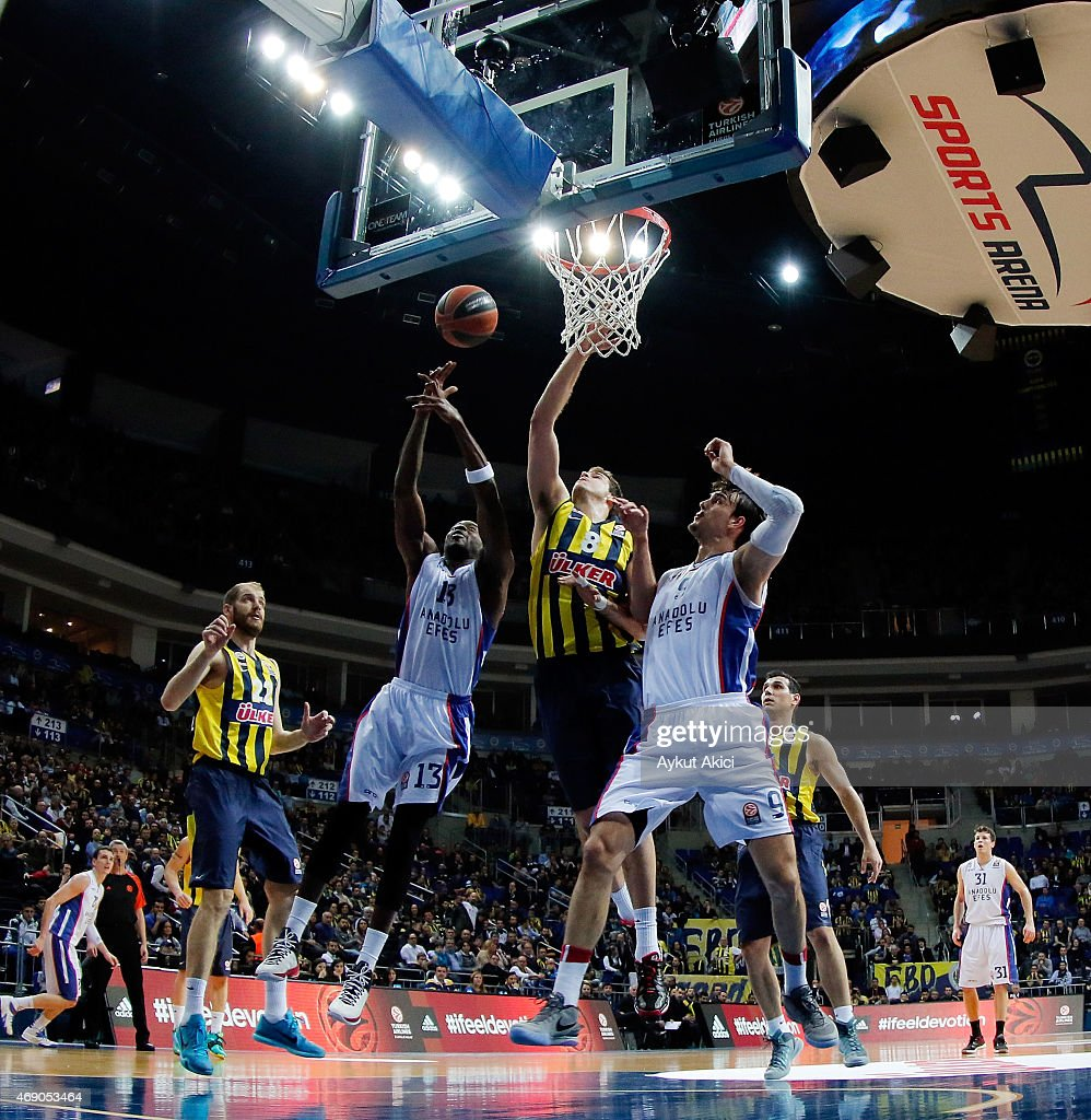 Stephane Lasme, #13 of Anadolu Efes Istanbul competes with Nemanja Bjelica, #8 of Fenerbahce Ulker Istanbul during the Turkish Airlines Euroleague Basketball Top 16 Date 14 game between Fenerbahce Ulker Istanbul v Anadolu Efes Istanbul at Ulker Sports Arena on April 9, 2015 in Istanbul, Turkey.