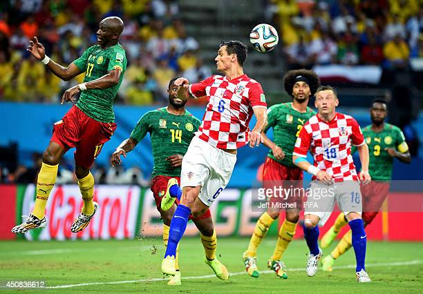 Stephane Mbia of Cameroon and Dejan Lovren of Croatia compete for the ball during the 2014 FIFA World Cup Brazil Group A match between Cameroon and...