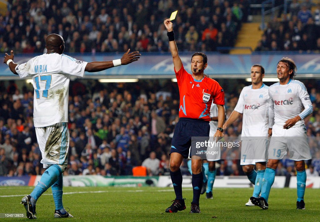 Stephane Mbia of Marseille(L) shows his disappointment to Referee, Frank de Bleeckere after conceding a penalty for handball during the UEFA Champions League Group F match between Chelsea and Marseille at Stamford Bridge on September 28, 2010 in London, England.