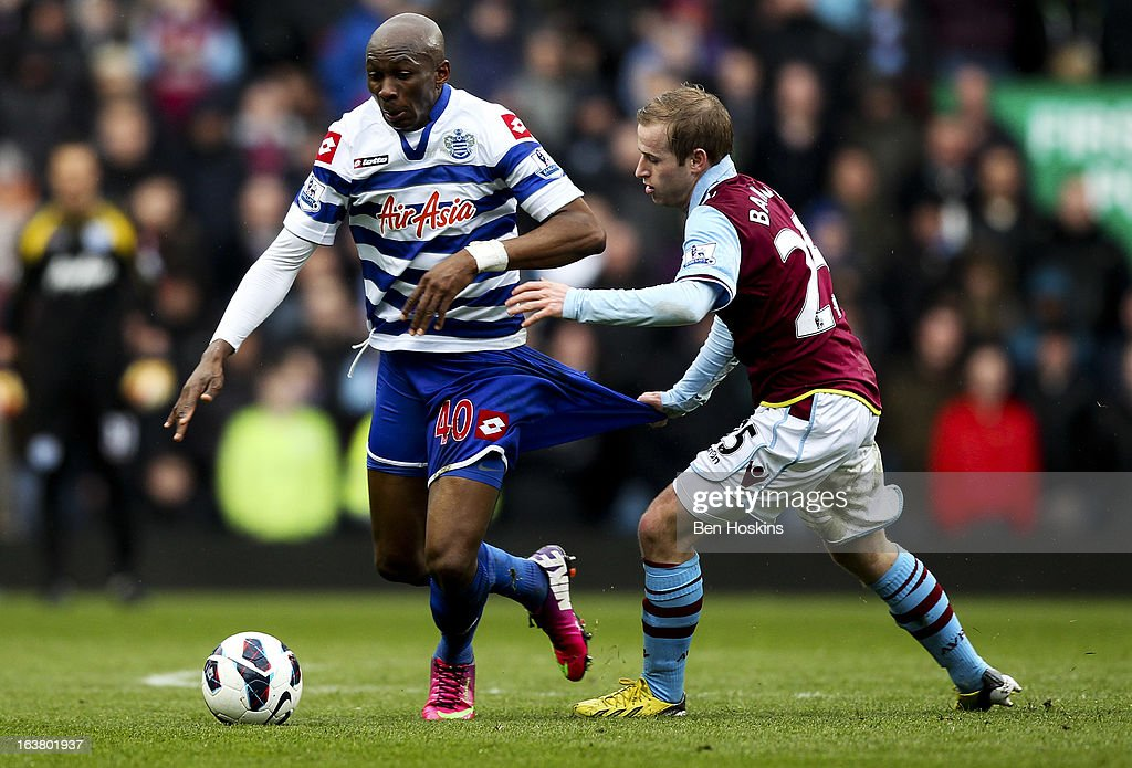 Stephane M'Bia of QPR holds off the challenge of Barry Bannan of Aston Villa during the Barclays Premier League match between Aston Villa and Queens Park Rangers at Villa Park on March 16, 2013 in Birmingham, England.