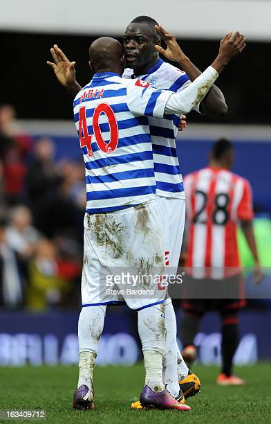 Stephane Mbia of Queens Park Rangers and Christopher Samba of Queens Park Rangers celebrate victory during the Barclays Premier League match between...