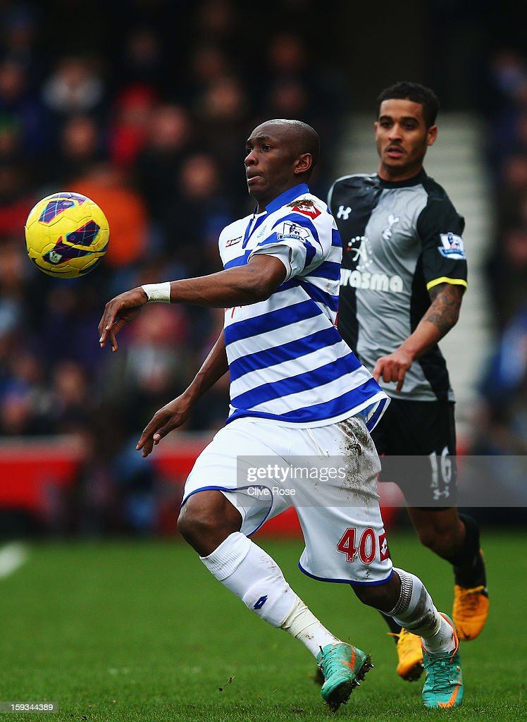 Stephane Mbia (L) of Queens Park Rangers holds off the challenge of <a gi-track='captionPersonalityLinkClicked' href=/galleries/search?phrase=Kyle+Naughton&family=editorial&specificpeople=5635202 ng-click='$event.stopPropagation()'>Kyle Naughton</a> (R) of Tottenham Hotspur during the Barclays Premier League match between Queens Park Rangers and Tottenham Hotspur at Loftus Road on January 12, 2013 in London, England.