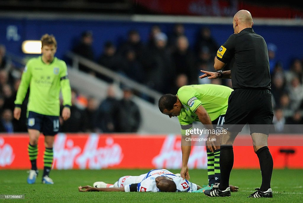 Stephane Mbia of Queens Park Rangers lies injured on the pitch during the Barclays Premier League match between Queens Park Rangers and Aston Villa at Loftus Road on December 1, 2012 in London, England.