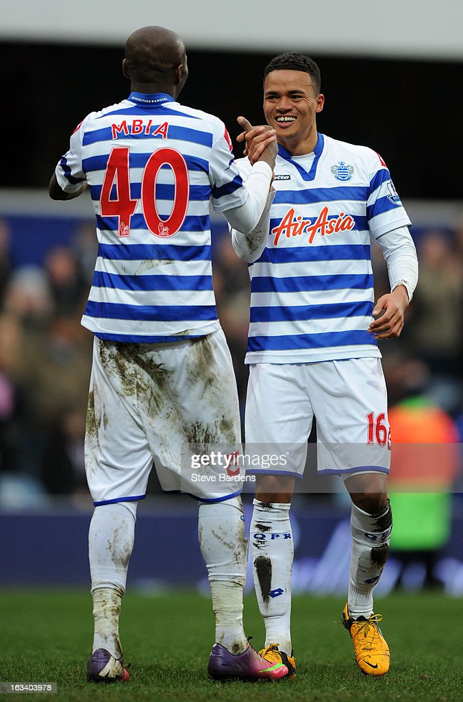 Stephane Mbia of Queens Park Rangers shakes hands with <a gi-track='captionPersonalityLinkClicked' href=/galleries/search?phrase=Jermaine+Jenas&family=editorial&specificpeople=212775 ng-click='$event.stopPropagation()'>Jermaine Jenas</a> of Queens Park Rangers at the final whistle during the Barclays Premier League match between Queens Park Rangers and Sunderland at Loftus Road on March 9, 2013 in London, England.