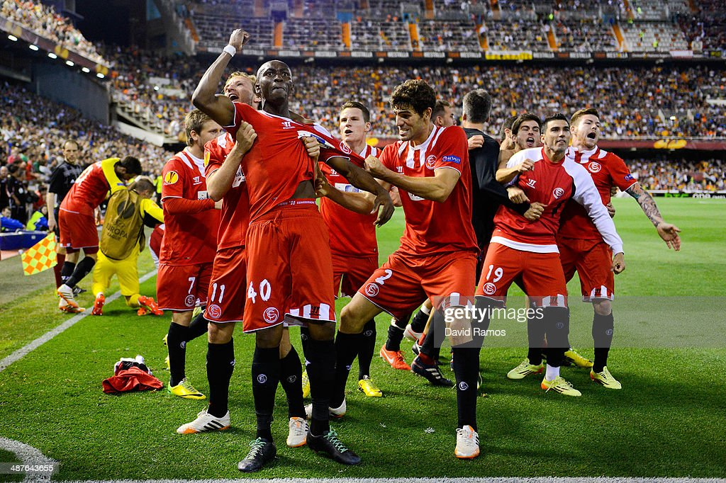 Stephane Mbia (C) of Sevilla FC celebrates after scoring his team's first goal during the UEFA Europa League Semi Final second leg match between Valencia CF and Sevilla FC at Estadi de Mestalla on May 1, 2014 in Valencia, Spain.