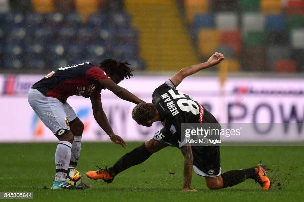 Stephane Omeonga of Genoa and Valon Behrami of Udinese compete for the ball during the Serie A match between Udinese Calcio and Genoa CFC at Stadio...