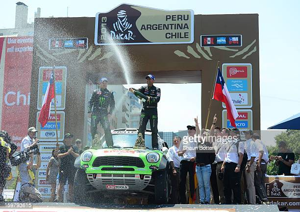 Stephane Peterhansel and codriver Jean Paul Cottret of team Mini 1st place in Autos celebrate during the podium presentations at the end of the 2013...