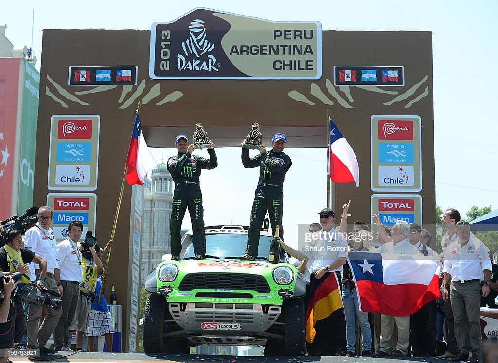 Stephane Peterhansel and co-driver Jean Paul Cottret of team Mini, 1st place in Autos, celebrate during the podium presentations at the end of the 2013 Dakar Rally on January 20, 2013 in Santiago, Chile.