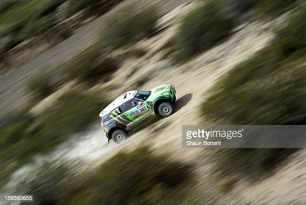 Stephane Peterhansel and codriver Jean Paul Cottret of Team Mini compete in Stage 8 from Salta to Tucuman during the 2013 Dakar Rally on January 12...
