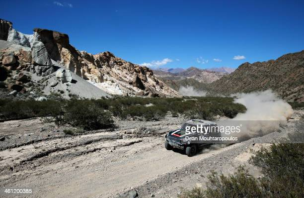 Stephane Peterhansel and Jean Paul Cottret of France for Mini Monster Energy XRaid Team compete on Day 3 of the Dakar Rally 2014 on January 7 2014 in...