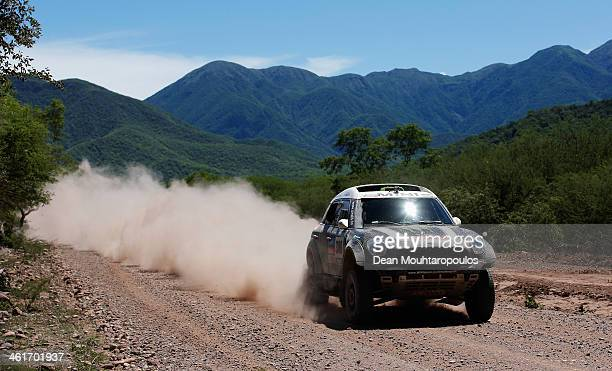 Stephane Peterhansel and Jean Paul Cottret of France for Mini Monster Energy XRaid Team compete during Day 6 of the 2014 Dakar Rally on January 10...