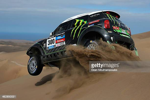 Stephane Peterhansel and Jean Paul Cottret of France for Mini Monster Energy XRaid Team compete in stage 10 on the way to Antofagasta during Day 11...