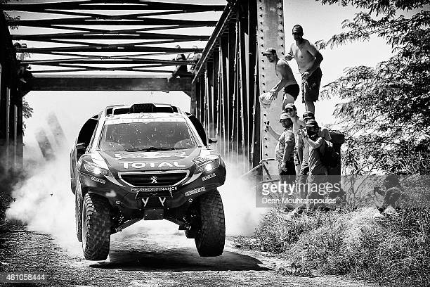 Stephane Peterhansel and JeanPaul Cottret of France for Team Peugeot Total in the Buggy 2008 DKR Peugeot compete during day 1 of the Dakar Rallly on...