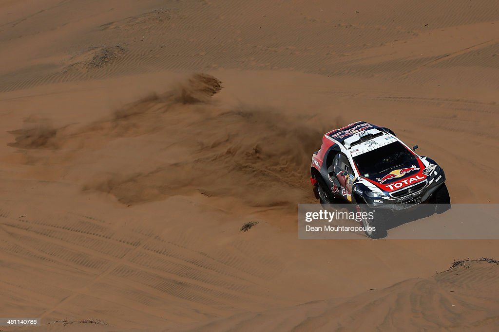 Stephane Peterhansel and Jean-Paul Cottret of France for Team Peugeot Total in the Buggy 2008 DKR Peugeot compete during day 4 of the Dakar Rallly on January 7, 2015 between Chilecito in Argentina to Copiapo, Chile.