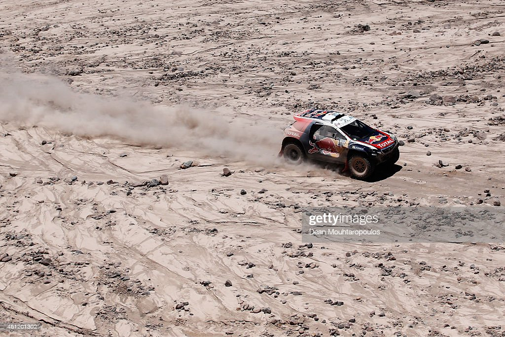 Stephane Peterhansel and Jean-Paul Cottret of France for Team Peugeot Total in the Buggy 2008 DKR Peugeot compete during day 5 of the Dakar Rallly on January 8, 2015 between Copiapo and Antofaasta near Altamira, Chile.