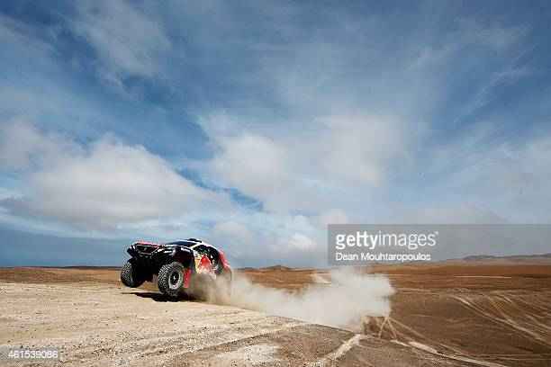 Stephane Peterhansel and JeanPaul Cottret of France for Team Peugeot Total in the Buggy 2008 DKR Peugeot compete in the Atacama Desert during day 10...