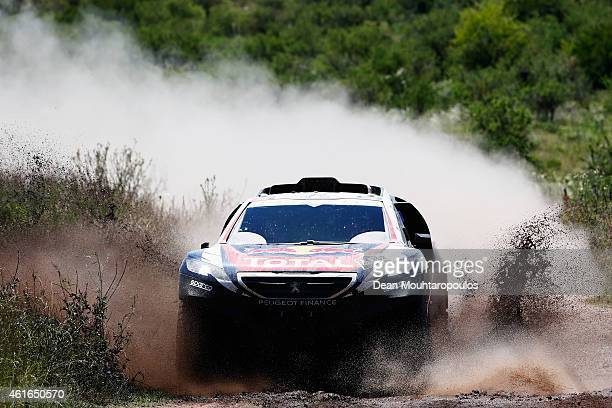 Stephane Peterhansel and JeanPaul Cottret of France for Team Peugeot Total in the Buggy 2008 DKR Peugeot compete during Stage 12 on day 13 of the...