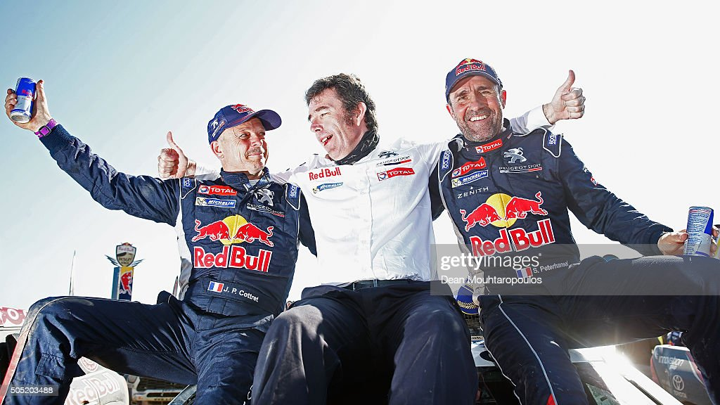 <a gi-track='captionPersonalityLinkClicked' href=/galleries/search?phrase=Stephane+Peterhansel&family=editorial&specificpeople=697906 ng-click='$event.stopPropagation()'>Stephane Peterhansel</a> (R) of France and Paul Jean Cottret (L) of France in the PEUGEOT 2008 DKR for TEAM PEUGEOT TOTAL SOUTH AFRICA celebrate winning the overall race with Bruno Famin (C), Director of Peugeot Sport as they arrive at the end of stage thirteen between Villa Carlos Paz and Rosario on day fourteen of the 2016 Dakar Rally on January 16, 2016 Rio Cuarto, Argentina.