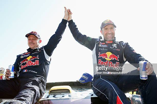 Stephane Peterhansel of France and Paul Jean Cottret of France in the PEUGEOT 2008 DKR for TEAM PEUGEOT TOTAL SOUTH AFRICA celebrate winning the...