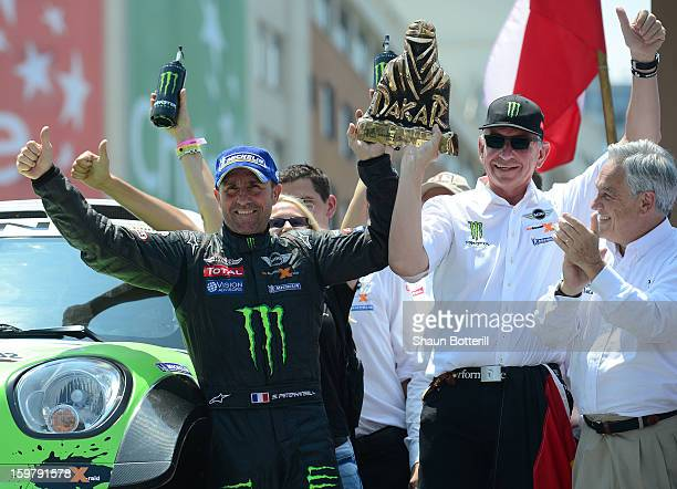 Stephane Peterhansel of France and team Mini 1st place in Autos celebrates during the podium presentations at the end of the 2013 Dakar Rally on...