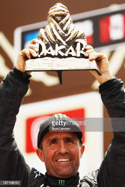 Stephane Peterhansel of France celebrates winning the car category of the 2012 Dakar Rally from Pisco to Lima on January 15 2012 in Lima Peru