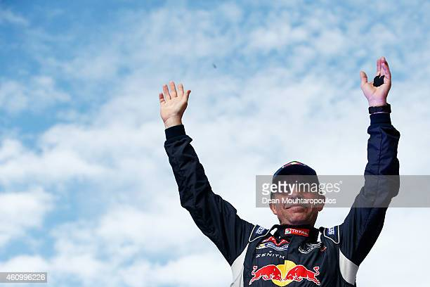 Stephane Peterhansel of France for Team Peugeot Total in the Buggy 2008 DKR Peugeot waves to the fans after his drive on the streets from the Obelisk...