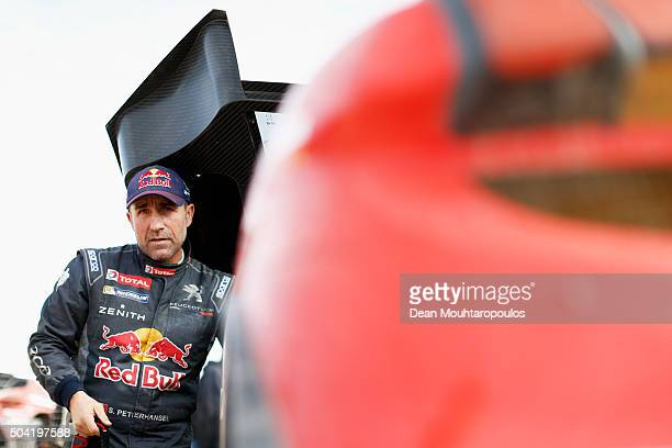 Stephane Peterhansel of France the PEUGEOT 2008 DKR for TEAM PEUGEOT TOTAL SOUTH AFRICA looks on before he competes on day 6 during stage six of the...