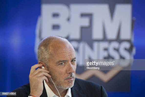 Stephane Richard chief executive officer of Orange SA adjusts an earpiece during a panel session at the MEDEF business conference in JouyenJosas...