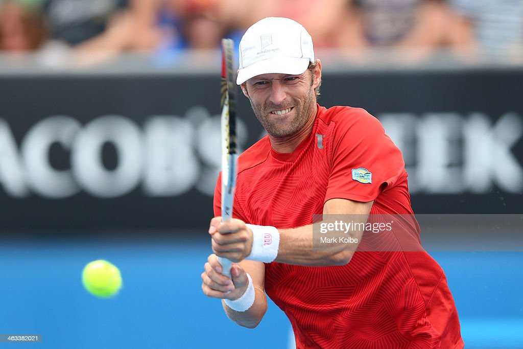 Stephane Robert of France plays a backhand in his third round match against Martin Klizan of Slovakia during day six of the 2014 Australian Open at Melbourne Park on January 18, 2014 in Melbourne, Australia.