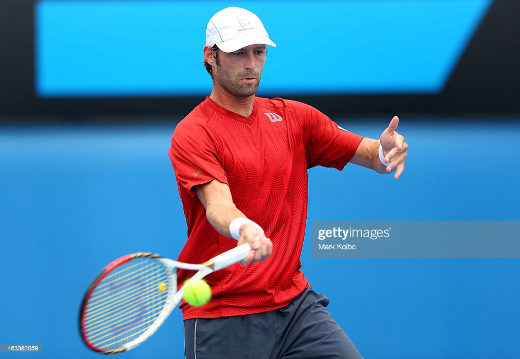 Stephane Robert of France plays a forehand in his third round match against Martin Klizan of Slovakia during day six of the 2014 Australian Open at Melbourne Park on January 18, 2014 in Melbourne, Australia.