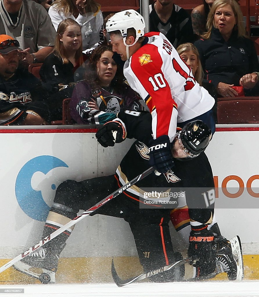 Stephane Robidas of the Anaheim Ducks collides with Joey Crabb of the Florida Panthers on March 23 2014 at Honda Center in Anaheim California