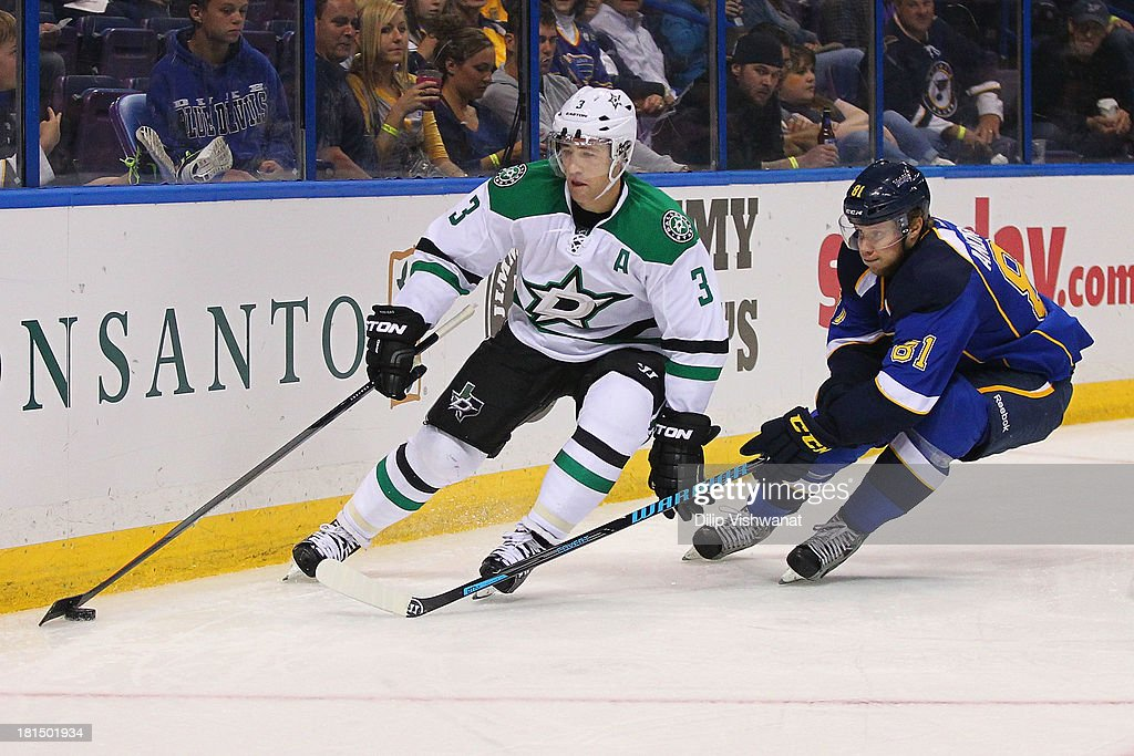 Stephane Robidas #3 of the Dallas Stars controls the puck against Sergei Andronov #81 of the St. Louis Blues during a preseason at the Scottrade Center on September 21, 2013 in St. Louis, Missouri. The Blues beat the Stars 3-2 in overtime.