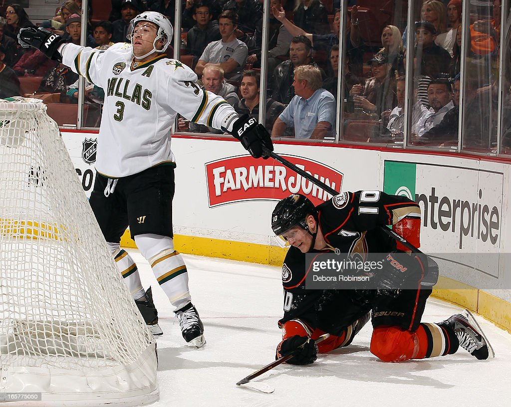 <a gi-track='captionPersonalityLinkClicked' href=/galleries/search?phrase=Stephane+Robidas&family=editorial&specificpeople=206166 ng-click='$event.stopPropagation()'>Stephane Robidas</a> #3 of the Dallas Stars has his stick caught on the jersey of <a gi-track='captionPersonalityLinkClicked' href=/galleries/search?phrase=Corey+Perry&family=editorial&specificpeople=213864 ng-click='$event.stopPropagation()'>Corey Perry</a> #10 of the Anaheim Ducks during the game on April 5, 2013 at Honda Center in Anaheim, California.