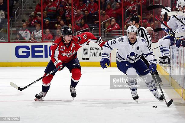 Stephane Robidas of the Toronto Maple Leafs moves the puck up ice against Nicklas Backstrom of the Washington Capitals in the first period during an...
