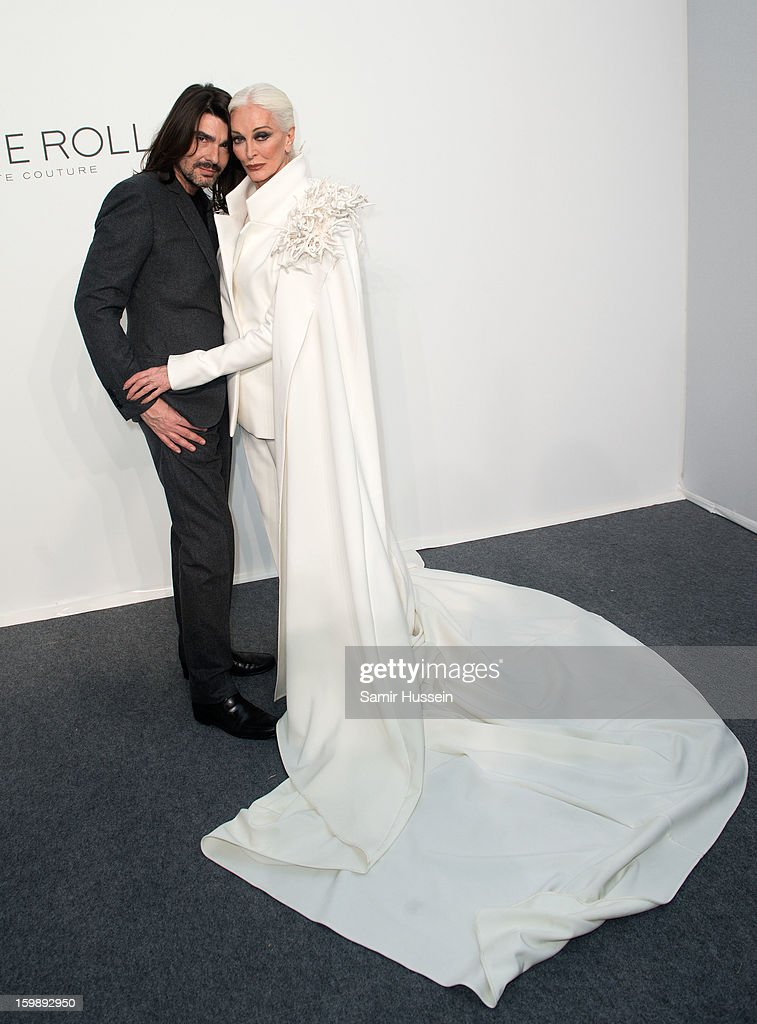 Stephane Rolland and <a gi-track='captionPersonalityLinkClicked' href=/galleries/search?phrase=Carmen+Dell%27Orefice&family=editorial&specificpeople=664172 ng-click='$event.stopPropagation()'>Carmen Dell'Orefice</a> (R) pose backstage at the Stephane Rolland Spring/Summer 2013 Haute-Couture show as part of Paris Fashion Week at Palais De Tokyo on January 22, 2013 in Paris France.