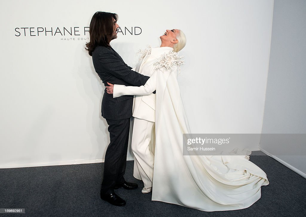 Stephane Rolland and Carmen Dell'Orefice (R) pose backstage at the Stephane Rolland Spring/Summer 2013 Haute-Couture show as part of Paris Fashion Week at Palais De Tokyo on January 22, 2013 in Paris France.