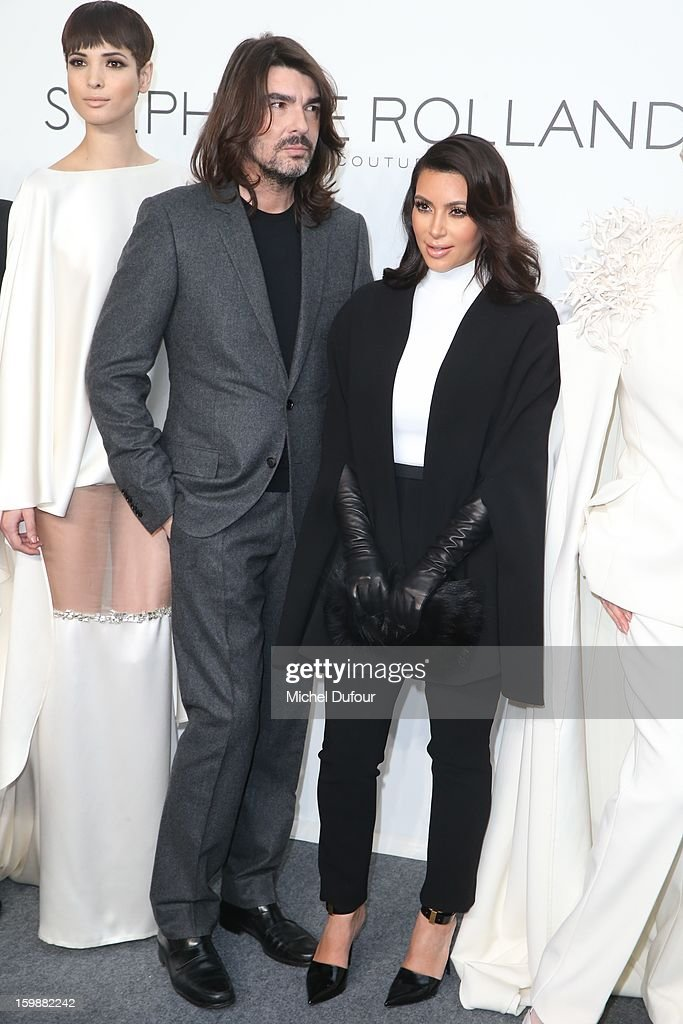 Stephane Rolland and Kim Kardashian attend the Stephane Rolland Spring/Summer 2013 Haute-Couture show as part of Paris Fashion Week at Palais De Tokyo on January 22, 2013 in Paris, France.