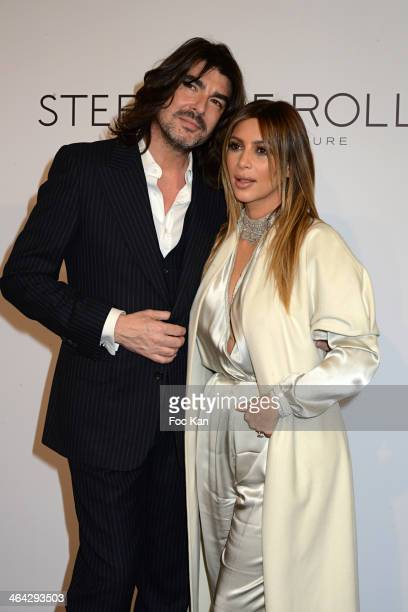 Stephane Rolland and Kim Kardashian attend the Stephane Rolland show during Paris Fashion Week Haute Couture S/S 2014 at Theatre National de Chaillot...