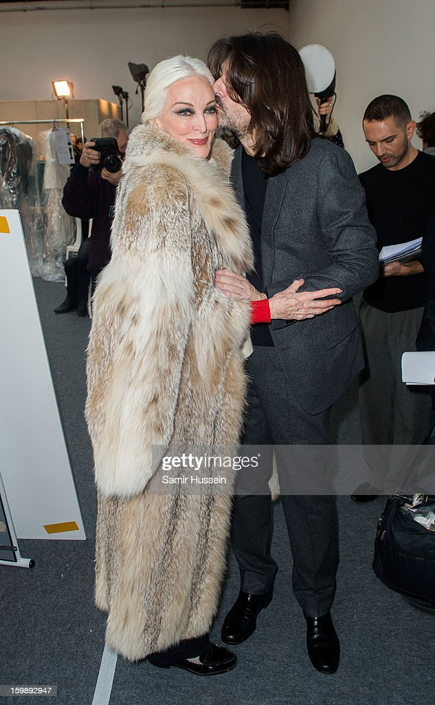 Stephane Rolland gives Carmen Dell'Orefice a kiss backstage at the Stephane Rolland Spring/Summer 2013 Haute-Couture show as part of Paris Fashion Week at Palais De Tokyo on January 22, 2013 in Paris France.