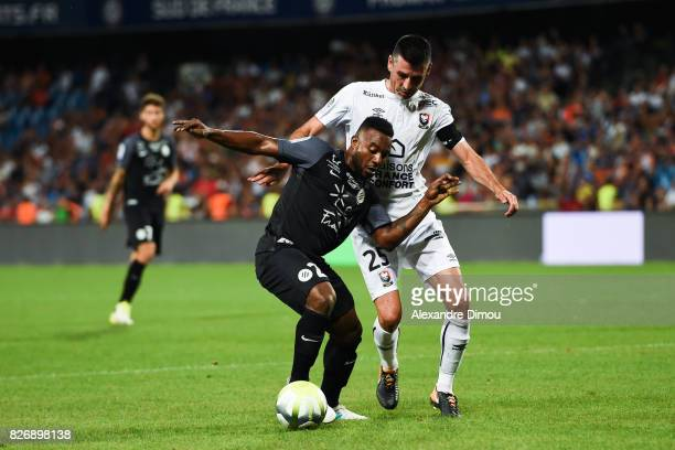 Stephane Sessegnon of Montpellier and Julien Feret of Caen during the Ligue 1 match between Montpellier Herault SC and SM Caen at Stade de la Mosson...