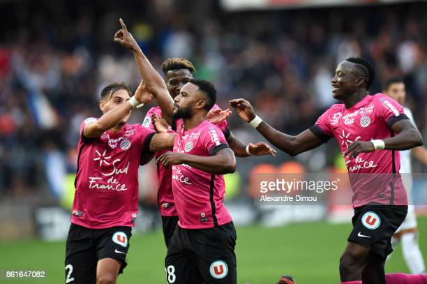 Stephane Sessegnon of Montpellier celebrates scoring his goal with team during the Ligue 1 match between Montpellier Herault SC and OGC Nice at Stade...