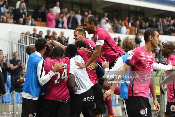 Stephane Sessegnon of Montpellier celebrates scoring his goal with teammates during the Ligue 1 match between Montpellier Herault SC and OGC Nice at...