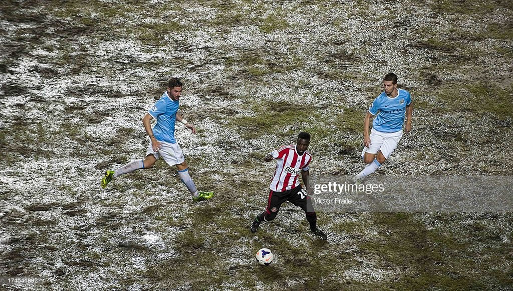 Stephane Sessegnon (C) of Sunderland AFC controls the ball ahead of Javi Garcia (L) and Matija Nastasic of Mancester City FC during the Barclays Asia Trophy Final match between Manchester City and Sunderland at Hong Kong Stadium on July 27, 2013 in So Kon Po, Hong Kong.